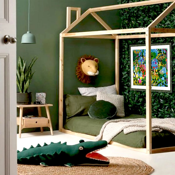 the jungle picture framed print on the wall of a jungle themed bedroom with a leafy wall