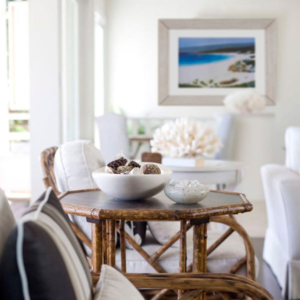 an insitue photograph of the smith beach limited edition in a beachy type home with dark natural wood furniture
