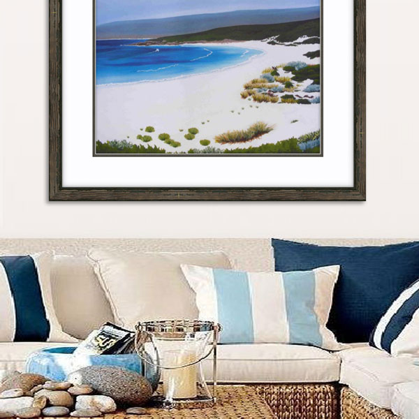an insitue photograph of the smith beach limited edition framed in natural wood above a light coloured lounge interior