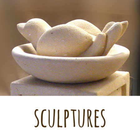 a concrete sculpture of a bird in a hand carved bowl