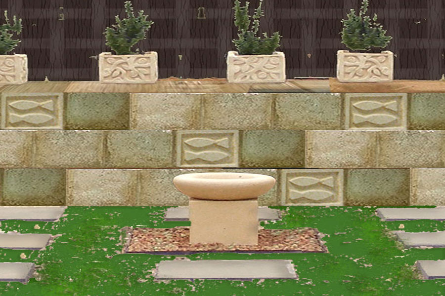 a photo of the very first garden area Mandy has been hard landscaping with the pots and blocks that she sculpts